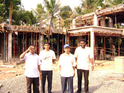 Dr. Palakeel infront of the construction site of the IMPACT centre's initial residence and office currently under construction.